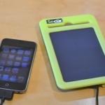 Sun Power Pad 2000 charging an iPhone